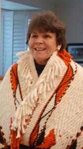 Gail-chief-smiling-miror-168x300